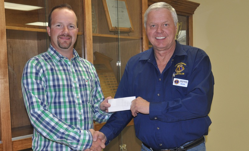 CMHA president Shane Hainstock accepts a cheque for $1,000 from Dean Mathison on behalf of the Chestermere Lions Club.