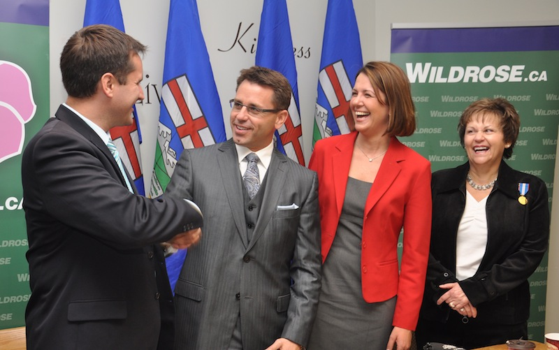 New Wildrose candidate Bruce McAllister shakes hands with current MLA Rob Anderson during a press conference on Oct. 14. Wildrose leader Danielle Smith and former candidate Heather Davies accompanied McAllister during his announcement.